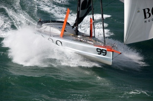 Aerial photo-shoot of the IMOCA Open 60 Alex Thomson Racing Hugo Boss during a training session before the Vendée Globe in the English Channel. The Vendée Globe is a round-the-world single-handed yacht race, sailed non-stop and without assistance.